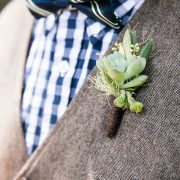 Succulent boutonniere on a groomsmen vest at a destination wedding by destination wedding planner Mango Muse Events
