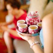Teapot and teacups for a Chinese tea ceremony at a Hawaii destination wedding by Destination wedding planner, Mango Muse Events