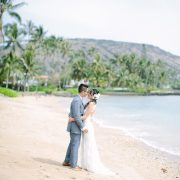 Bride and groom on the beach at their Hawaii destination wedding by Destination wedding planner, Mango Muse Events