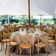 Wedding reception tent with floor length tablecloths for a rustic Sonoma destination wedding by Destination wedding planner, Mango Muse Events