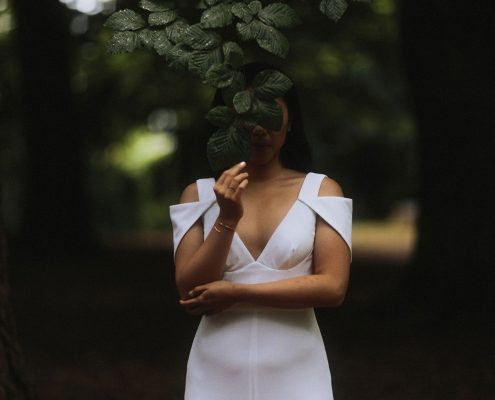 Destination bride taking a moment by herself in the forest at her Vancouver destination wedding by Destination wedding planner, Mango Muse Events