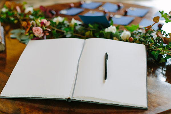 A wedding story book serving also as a guest book at a France destination wedding by Destination wedding planner, Mango Muse Events