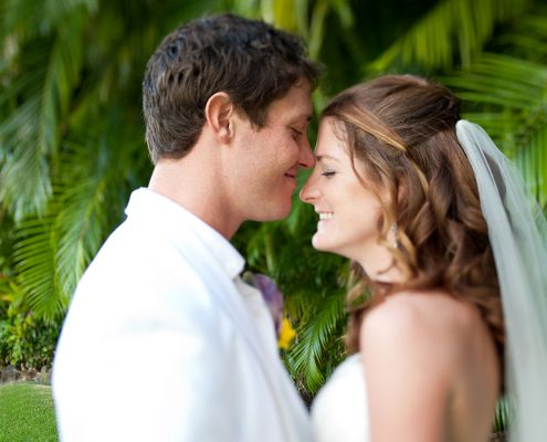 Newlywed couple taking a moment alone at a Hawaii destination wedding by Destination wedding planner, Mango Muse Events