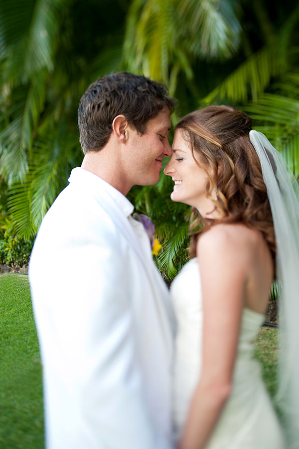 Bride and groom taking a moment and smiling at their destination wedding in Hawaii by destination wedding planner Mango Muse Events