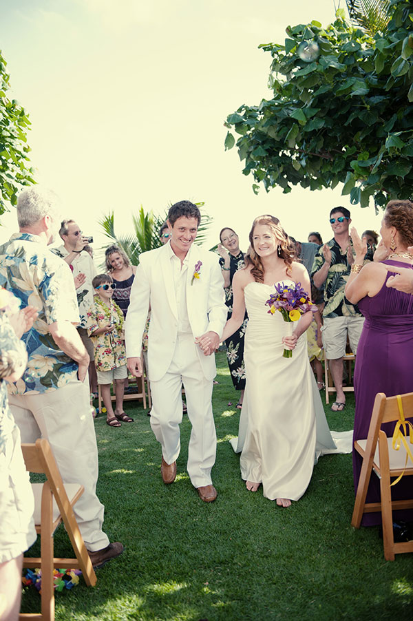 Newlyweds after their wedding ceremony in Hawaii planned by Destination wedding planner, Mango Muse Events