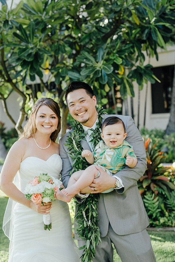 Bride and groom and their new son celebrating their wedding in Hawaii planned by Destination wedding planner, Mango Muse Events