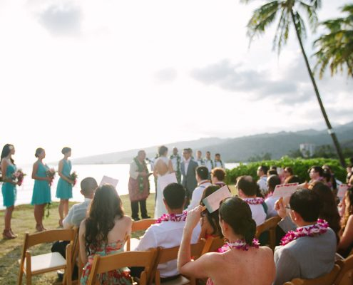 A wedding ceremony right in front of the ocean at a Hawaii destination wedding by destination wedding planner Mango Muse Events