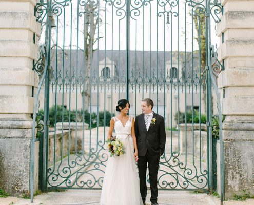 Bride and groom at their French chateau wedding in Loire Valley, France planned by Destination wedding planner, Mango Muse Events