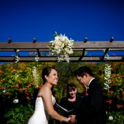 Bride and groom smiling at their destination wedding ceremony in Sonoma by Destination wedding planner, Mango Muse Events