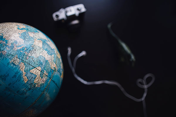 world globe and camera