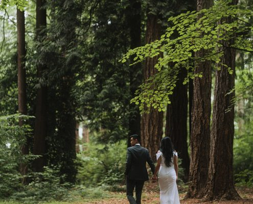Bride and groom walking in the forest at their Vancouver destination wedding by Destination wedding planner, Mango Muse Events