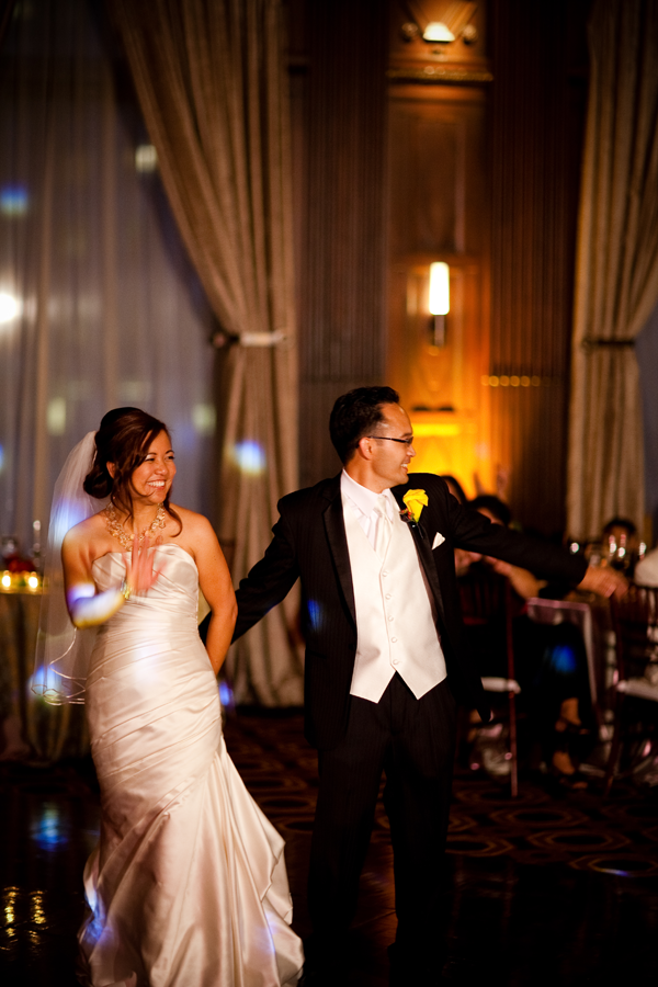 Bride and groom on the dance floor at their San Francisco wedding reception at the Julia Morgan Ballroom by Destination wedding planner Mango Muse Events