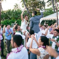 Newlyweds and guests dancing at destination wedding reception in Hawaii by Jamie Chang destination wedding planner of Mango Muse Events