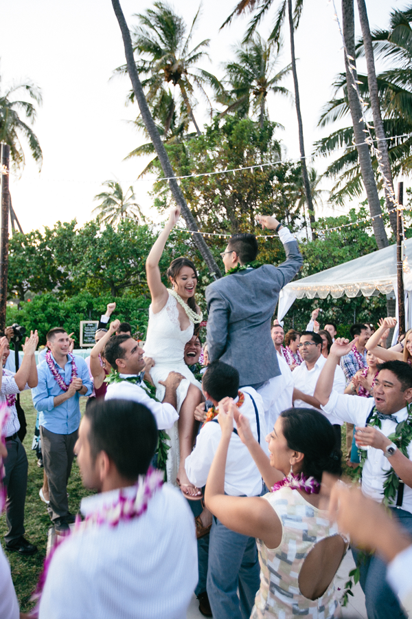 Newlyweds and guests dancing at destination wedding reception in Hawaii by destination wedding planner of Mango Muse Events