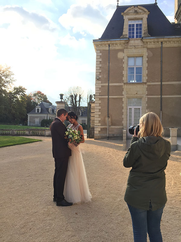 Photographer taking a photo of a bride and groom at their destination wedding in France planned by Destination wedding planner, Mango Muse Events
