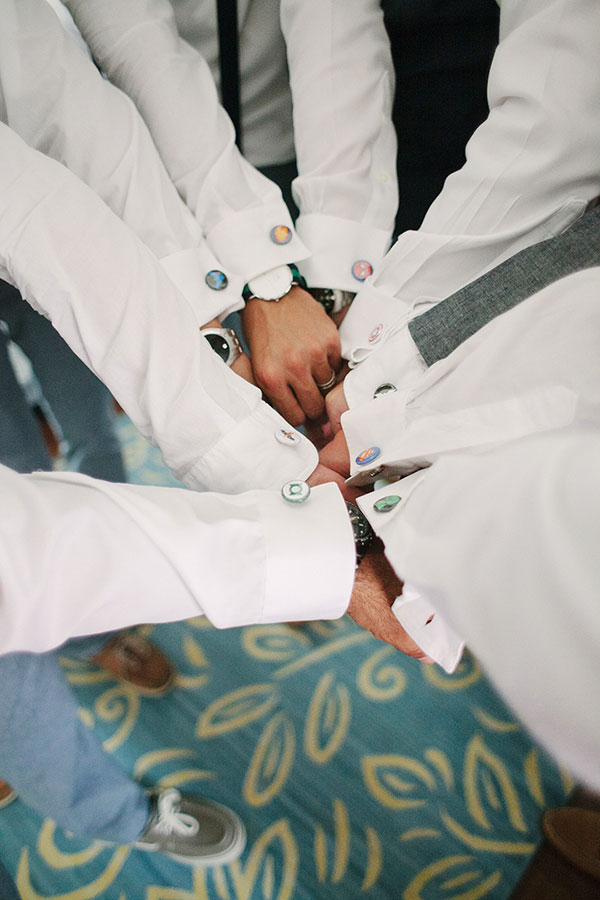 Groomsmen and their superhero cufflinks at a Hawaii destination wedding by Destination wedding planner, Mango Muse Events