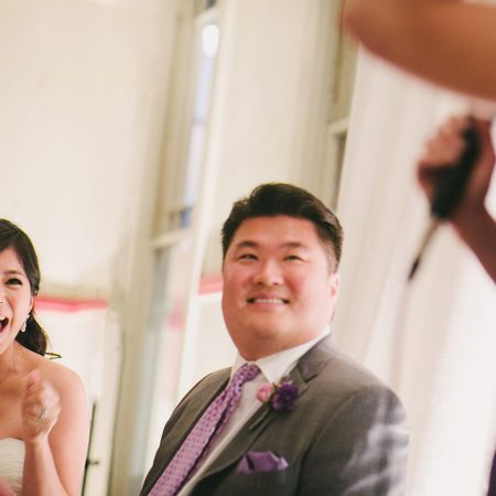 Bride and groom laughing during toasts at their San Francisco destination wedding by Destination wedding planner Mango Muse Events