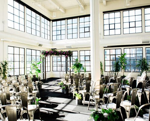Conservatory inspired wedding ceremony setup at Terra Gallery in San Francisco by Destination wedding planner Mango Muse Events