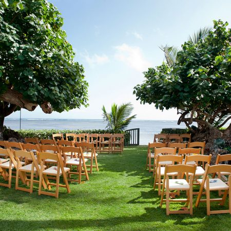 Intimate oceanside private estate wedding ceremony in Hawaii by Destination wedding planner Mango Muse Events
