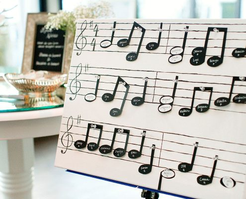 Music note seating cards designed by Destination wedding planner Mango Muse Events