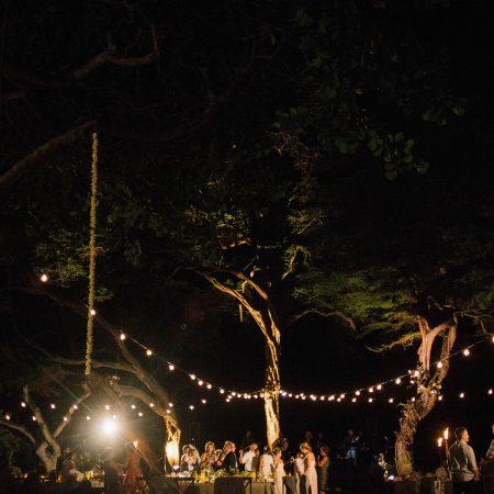Outdoor wedding reception with bistro lights at a Big Island Hawaii destination wedding by Destination wedding planner Mango Muse Events
