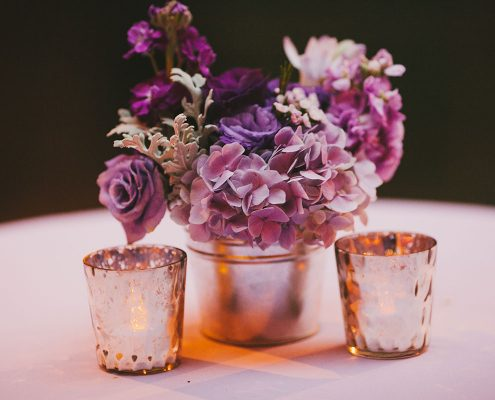 Purple flower centerpiece for a San Francisco destination wedding by Destination wedding planner Mango Muse Events