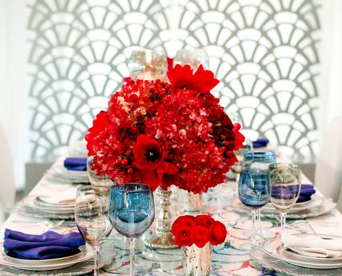 Red white and blue painted wedding tablescape at the Conservatory of Flowers in San Francisco by Destination wedding planner Mango Muse Events