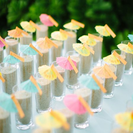 Sand cocktail umbrella seating cards for a Hawaii destination wedding by Destination wedding planner Mango Muse Events