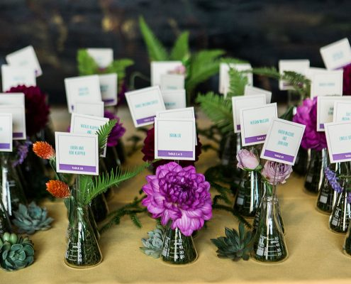 Flask seating cards for a science inspired wedding in San Francisco by destination wedding planner, Mango Muse Events