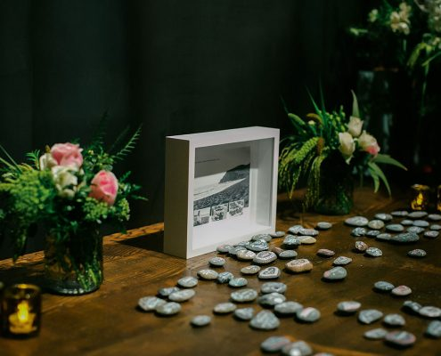 River rock seating cards at a San Francisco wedding at Bluxome winery by Destination wedding planner Mango Muse Events
