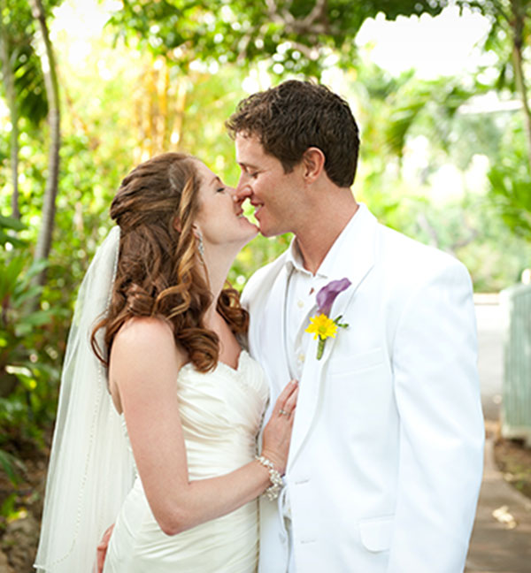 Bride and groom at their private estate Hawaii destination wedding by Destination wedding planner, Mango Muse Events