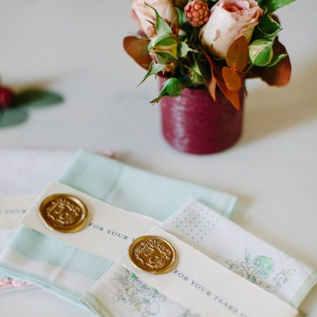 Vintage handkerchiefs at a France chateau wedding by Destination wedding planner Mango Muse Events