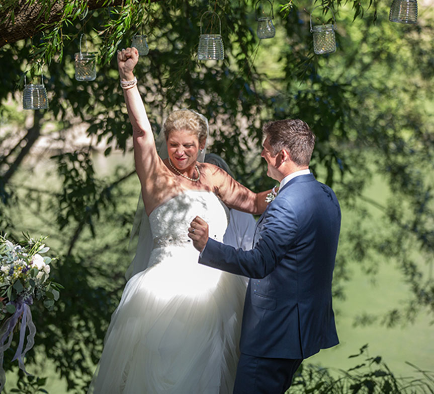 Bride and groom fist pump at their Monte Rio wedding ceremony by Destination wedding planner by Mango Muse Events