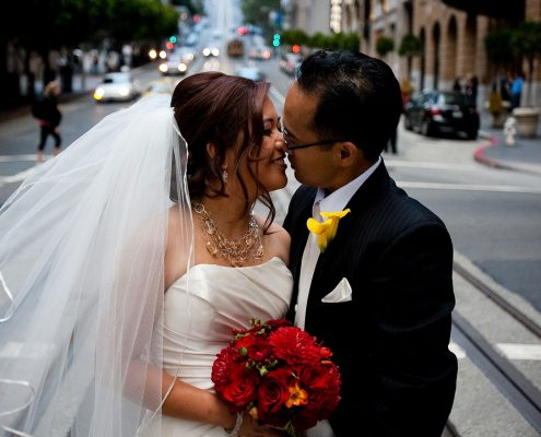 Bride and groom kissing at their San Francisco wedding by Destination wedding planner Mango Muse Events