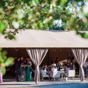 Wedding guests enjoying cocktails at a wine country wedding at Calistoga Ranch by destination wedding planner Mango Muse Events