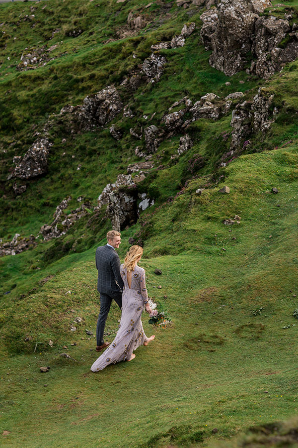 Bride and groom first steps as newlyweds Quiraing Isle of Skye Scotland destination wedding by destination wedding planner Mango Muse Events