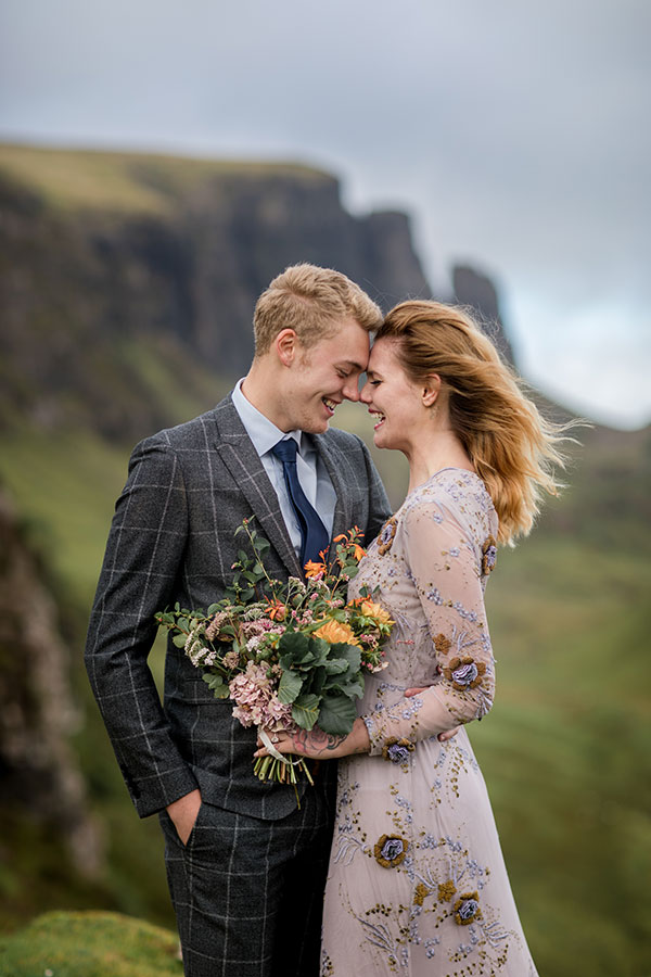 Bride groom wedding day laughing Quiraing Isle of Skye Scotland destination wedding by destination wedding planner Mango Muse Events
