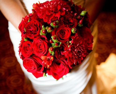 Red bridal wedding bouquet Valentine's day wedding inspiration by destination wedding planner Mango Muse Events