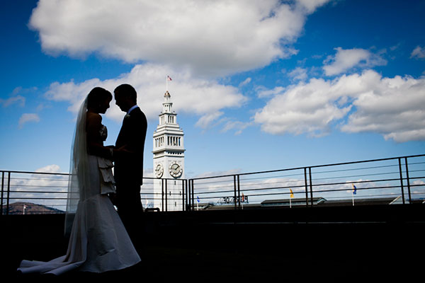 Bride and groom first look with a Ferry Building backdrop at their San Francisco Wedding by Destination wedding planner Mango Muse Events