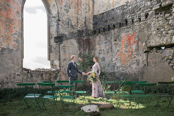 Bride and groom at their intimate wedding ceremony in church ruins in an Isle of Skye Scotland destination wedding by destination wedding planner Mango Muse Events