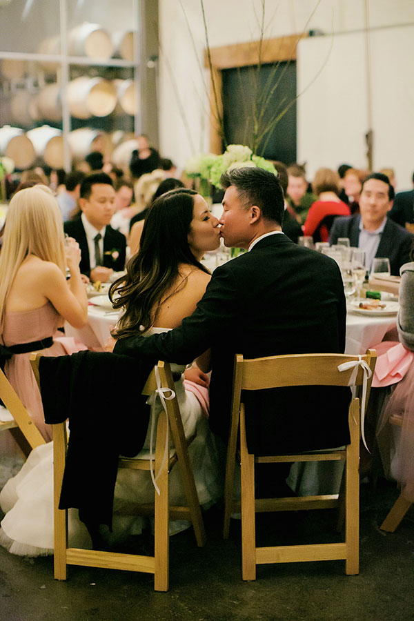 Bride and groom wedding kiss at a San Francisco wedding reception at Bluxome Winery by Destination wedding planner Mango Muse Events
