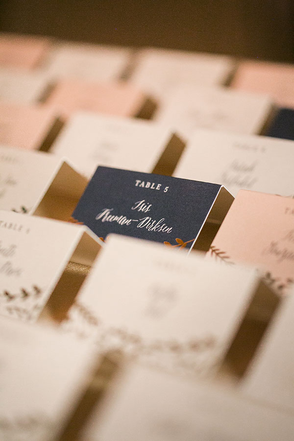 Multi colored seating cards for a plated meal for an elegant destination wedding in San Francisco by Destination wedding planner Mango Muse Events