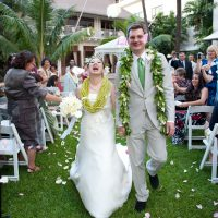 Bride and groom just married walking down the aisle at a destination wedding in Hawaii by Destination wedding planner Mango Muse Events