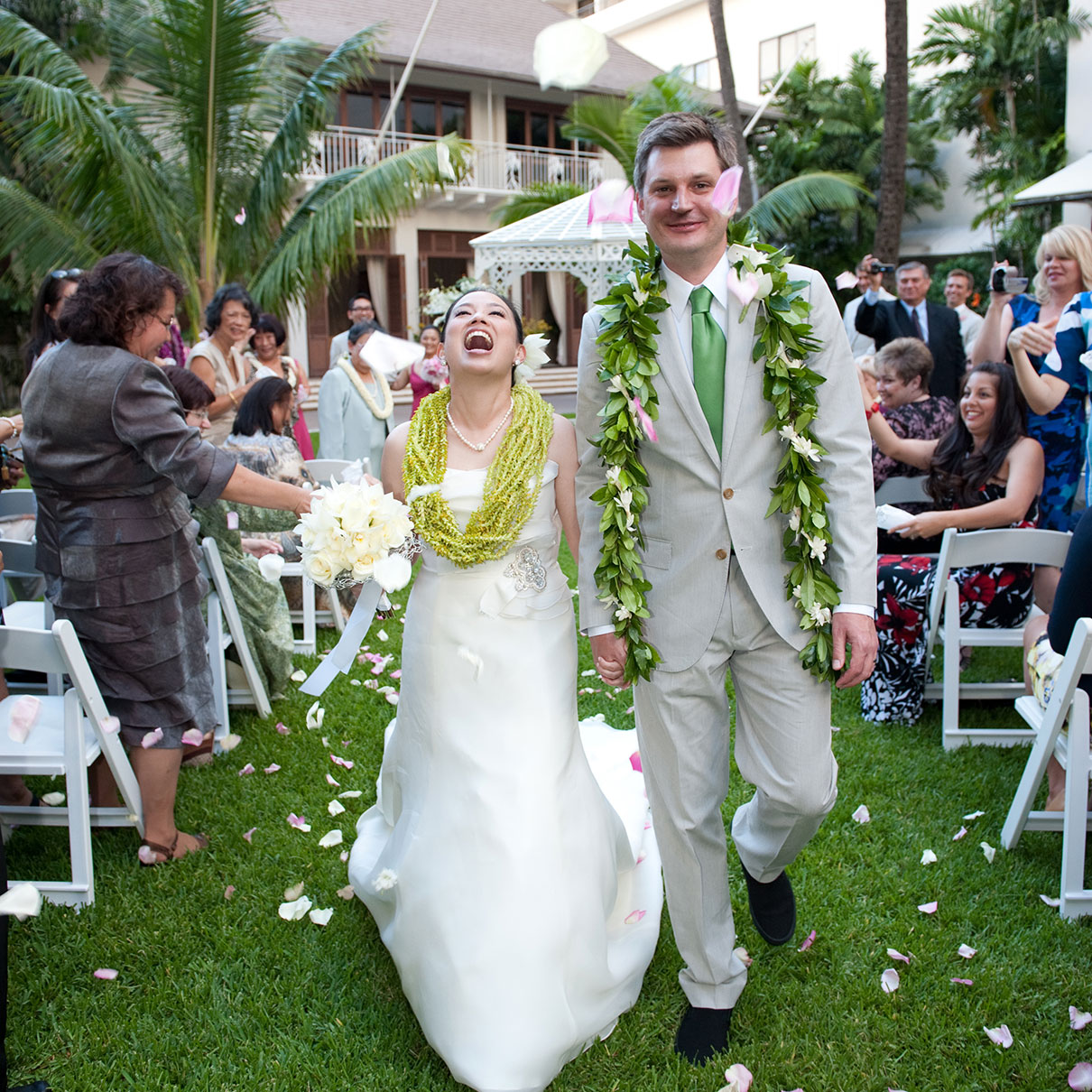 6c29306cd9 Bride and groom just married walking down the aisle at a destination wedding  in Hawaii by