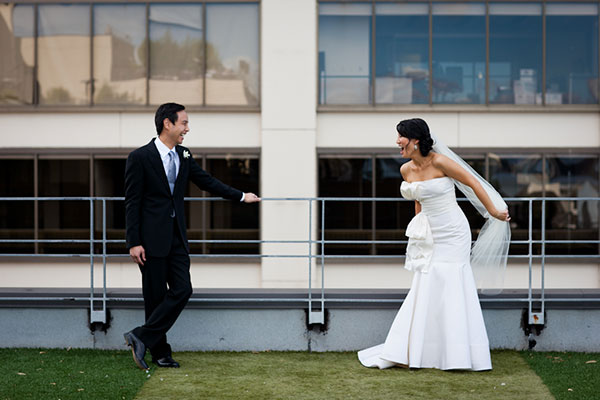 Bride and groom playfully face off at a San Francisco wedding by Destination wedding planner Mango Muse Events
