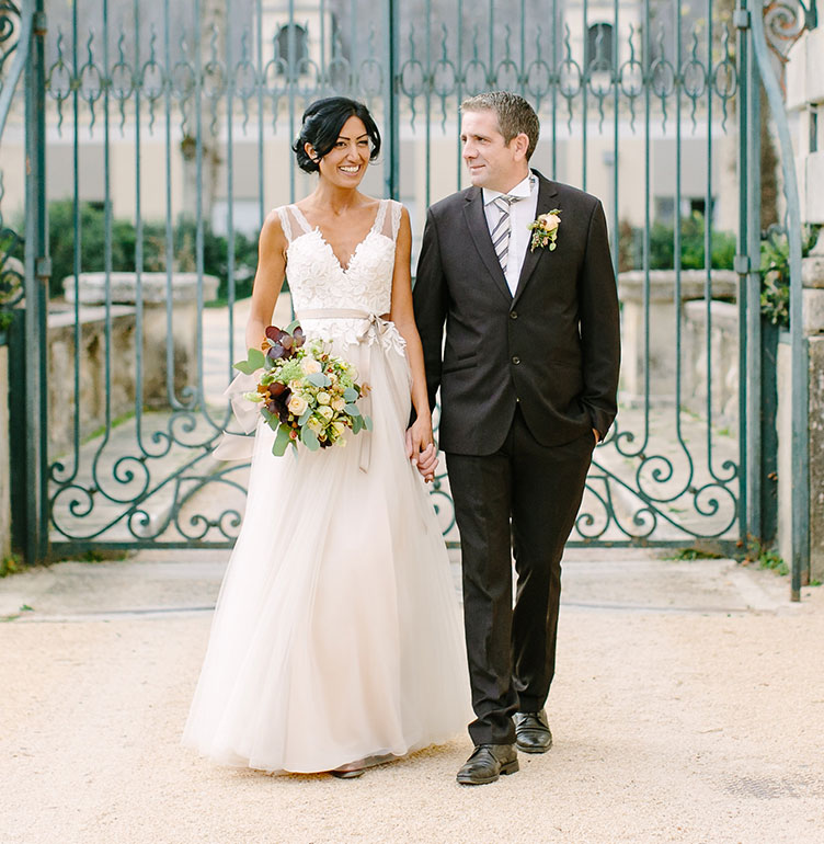 Bride and groom at their France Chateau wedding by Destination wedding planner Mango Muse Events