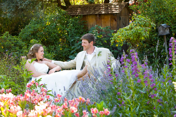 Newlyweds sitting in the garden at their spring garden wedding in Healdsburg wine country by Destination wedding planner, Mango Muse Events