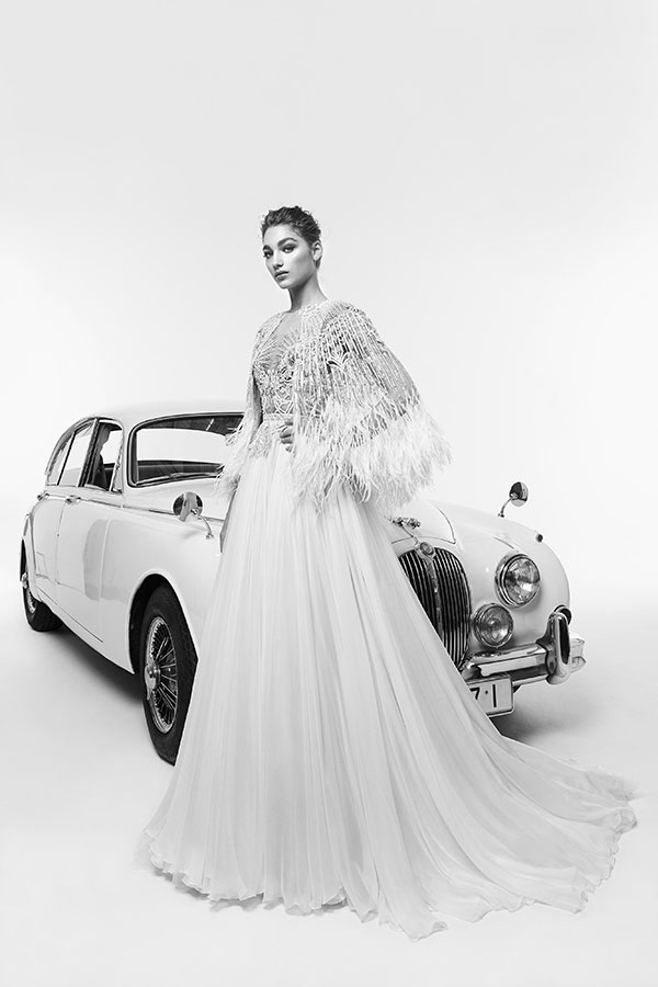 Fur shrug and gatsby style wedding dress by Zuhair Murad best wedding dresses from Bridal Fashion Week Spring 2019