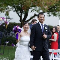 Happy couple just married at their wedding ceremony by destination wedding planner Mango Muse Events