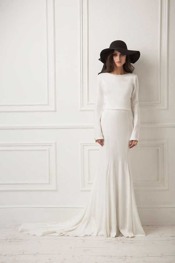 Long sleeve modern wedding dress with black hat by Dreams by Lihi Hod best wedding dresses from Bridal Fashion Week Spring 2019